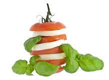 Stacked tomato mozzarella and fresh basil Stock Images