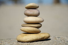Stacked tower of rocks, relaxing game. Relaxing game with some different pebbles royalty free stock images