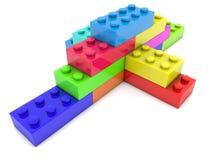 Stacked toy bricks in corner on white Royalty Free Stock Image