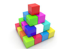 Stacked toy cubes in pyramid on white Stock Photo