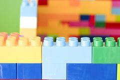Stacked toy plastic building blocks. Colorful stacked toy plastic building blocks Royalty Free Stock Photography
