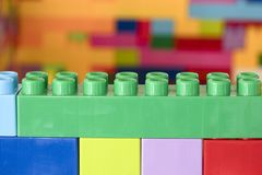 Stacked toy plastic building blocks. Colorful stacked toy plastic building blocks stock photo