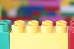 Stacked toy plastic building blocks. Colorful stacked toy plastic building blocks royalty free stock photo