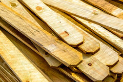 Stacked unpainted wood picket fence lumber Stock Photos