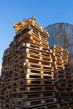 Stacked up colorful wooden cargo pallets. Against a blue sky Royalty Free Stock Photos