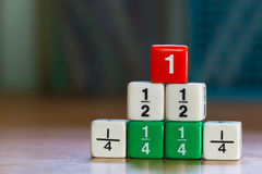 Stacked up fraction dices Royalty Free Stock Images