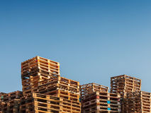 Stacked up pallets against a blue sky Royalty Free Stock Image