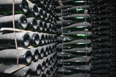 Stacked up wine bottles in the cellar Stock Photography