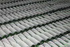 Stacked up wine bottles in the cellar. Close-up Royalty Free Stock Photos