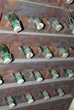 Stacked up wine bottles in the cellar. Close-up Stock Photography