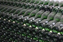 Stacked up wine bottles in the cellar. Close-up Stock Photos