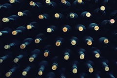 Stacked up wine bottles. In the cellar Stock Images