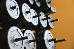 Stacked weights and barbells. Stock Photos