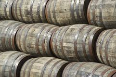 Stacked whisky barrels. In a cooperage in scotland Royalty Free Stock Images