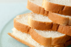 Stacked white bread slices. White bread slices stacked on a glass surface Stock Photography