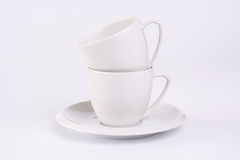 Stacked white cups and saucer Royalty Free Stock Images