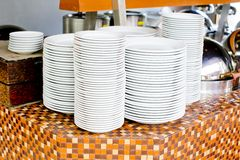 Stacked white dishes Royalty Free Stock Photography