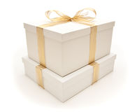 Stacked White Gift Boxes with Gold Ribbon Isolated Stock Photography