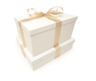 Stacked White Gift Boxes with Gold Ribbon Isolated Royalty Free Stock Image