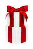 Stacked white and red Christmas gift boxes isolated Royalty Free Stock Images