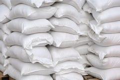 Stacked white sacks Stock Photo