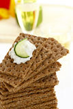 Stacked wholemeal crispbread with cream cheese and cucumber slice Stock Photos
