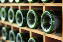 Stacked of wine bottles in the cellar Royalty Free Stock Photography