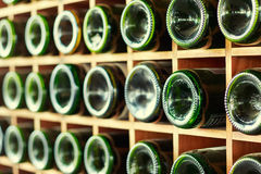 Stacked of wine bottles in the cellar Royalty Free Stock Images