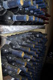 Stacked wine bottles in the old cellar of the winery Royalty Free Stock Photo