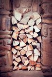Stacked wood. Pile of firewood stored in stone bay Royalty Free Stock Image
