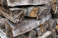 Stacked wood logs, criss-cross pattern method royalty free stock photos
