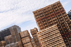 Stacked wood pallets and  material Royalty Free Stock Photos