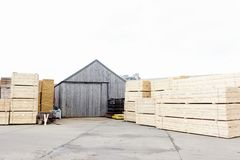 Stacked wood stored at sawmill for biomass fuel. Uk royalty free stock photo