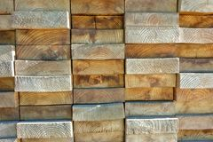 Wood boards stacked highly tightly. Stacked wooden board pattern with irregularities Royalty Free Stock Image