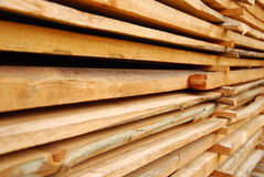 Stacked wooden boards. Different sizes Stock Photography