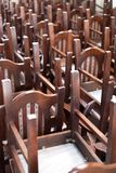 Stacked wooden classic chairs, vintage objects Royalty Free Stock Images