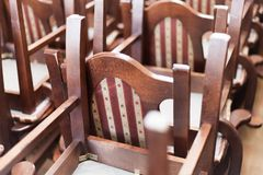 Stacked wooden classic chairs Stock Image