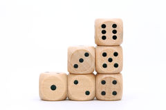 Stacked wooden dice. On a white background Royalty Free Stock Photos