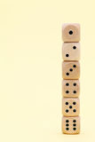 Stacked wooden dice. On a yellow background Stock Photography