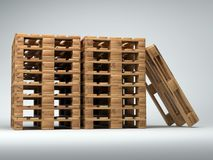 Stacked wooden pallets. Piles of wooden warehouse pallets shot on light gray background Stock Photography