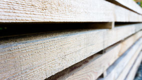 Stacked wooden planks. For housebuilding Royalty Free Stock Images