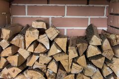 Stacked woodpile. Texture of the firewood. Stacked woodpile Royalty Free Stock Photography