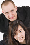 Stacked young couple Stock Images