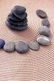 Stacked zen stones and stones in circle Stock Photo