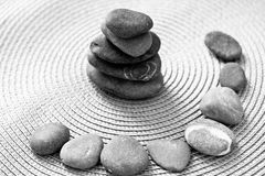 Stacked zen stones and stones in circle, bw Stock Photo