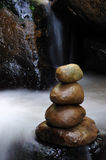 Stacked of zen stones and waterfall Stock Images