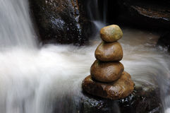 Stacked of zen stones and waterfall Stock Photo