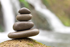 Stacked zen stones and waterfall Royalty Free Stock Photo