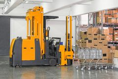 Stacker forklift. Electric forklift stacker in warehouse with boxes Stock Photo