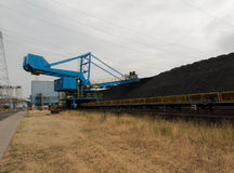 Stacker with a heap of coal Stock Photo